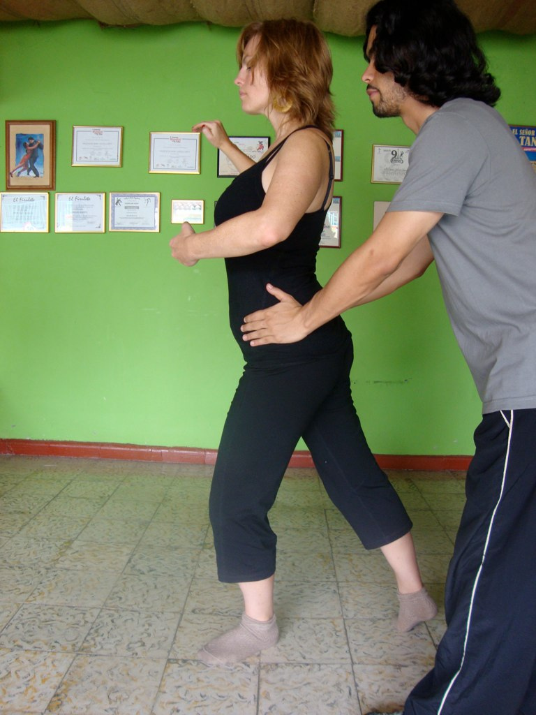 My first teacher Mauricio corrects my hips