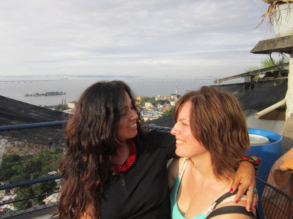 me and my friend iracema, this is the spot at the top of the hill which the city wants to turn into a tourist overlook (and is willing to displace hundreds of families to do)