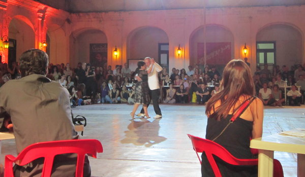 a celebrated tango couple Osvaldo y Coco performing at a festival in Buenos Aires: notice the balance