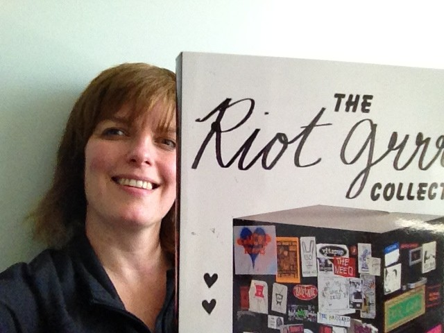 Holding my copy of the Riot Grrrl Collection, I'm so proud and happy my zine writings from Cupsize are in this book!