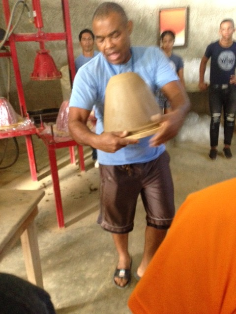 Making a clay water filter with liquid silver and sawdust with the organization Wine to Water in the DR
